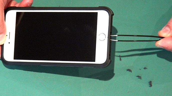 A Person cleaning iphone charging port