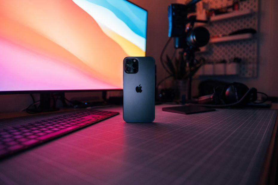 white iphone 5 c on purple laptop computer