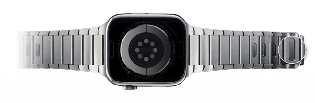 Quick release buttons on watch band links.